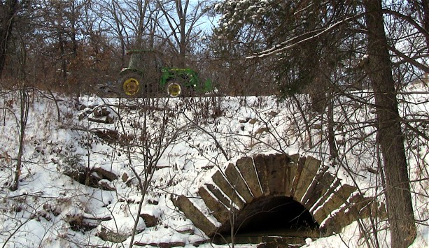 Tractor Clearing Snow From Roadway Over CCC Culvert
